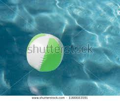 swimming pool beach ball background. One Bright Green Beach Ball In Blue Swimming Pool, Floating Refreshing  Pool With Background
