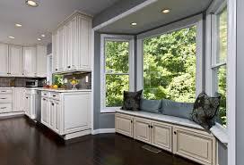 Dark Mahogany Wood Floor, Stone Wall, Bench Seat Bring Kitchen to Life  contemporary-