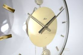 vintage acrylic and brass wall clock