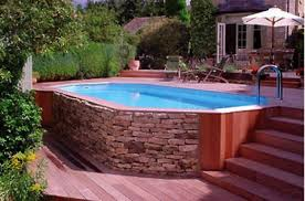 Image Backyard This Above Ground Pool Deck Has An Amazing Wood And Stone Deck Skirt Pinterest Awesome Above Ground Pools Pools In Ground Pools Above Ground