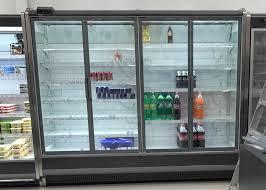 glass door merchandiser refrigerator with large glass door and vertical led lighting