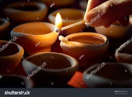 hand lighting. Hand Holding A Matchstick Lighting Diya Lamps During Diwali Celebration G