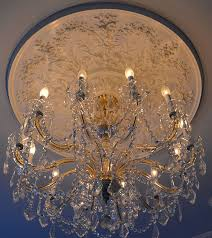 large decorative ceiling medallion and crystal chandelier