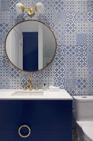 blue bath vanity with blue mosaic tiles