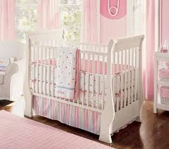 baby girl nursery ideas purple white dresser wooden platform green pattern quilt gray stained wall small