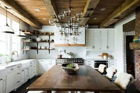 rafters living lighting. Country Kitchen With Exposed Rafters, A Brick Hearth, Custom Lighting And Large Farmhouse Table As The Centerpiece In This Home Designed By Leanne Ford Rafters Living E