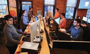 Office work desks Modern Hubspot Employees Work At Their Standing Desks In Cambridge The Boston Globe Yes Sitting At Work Is Bad But Is Standing Actually Better The