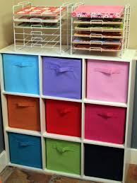 White Storage Shelves And Colorful Fabric Kids Storage Bins Also Storage  Rack
