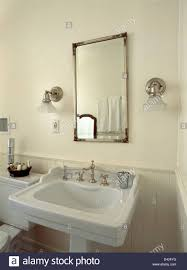 above mirror lighting bathrooms. Glass Shades On Chrome Wall Lights Either Side Of Mirror Above White Pedestal Basin In Bathroom Lighting Bathrooms