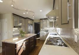 led track lighting kitchen. white countertop with cabinets and sink plus stove also led track lighting wood flooring kitchen d
