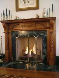 this fireplace mantel is well over 100 years old it was salvaged from a house