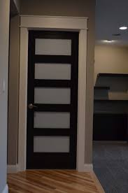 stacked panel door with glass inserts