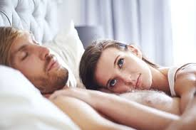 one in three men admit faking orgasms but women are still the a w laying on sleeping man in bed