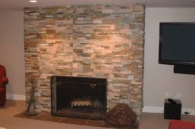 the red tile hearth gives that traditional feel while the stacked stone bring modern elements this is a working wood fireplace