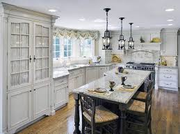 rustic kitchen combined with dining room for saving small spaces plus black iron hanging french country chandelier lamp shades above black dining table with