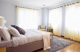 rug for bedroom. this lavender bedroom is complemented beautifully by shag rug at the end of bed. it protects beautiful hardwood flooring from for