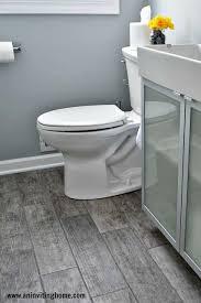 porcelain tiles bathroom. modern bathroom update with porcelain wood tiles, wall color \u2013 benjamin moore \u201csilver lake\u201d in matte finish tiles