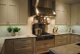 view full size gorgeous kitchen features white cabinets paired with super white countertops and beveled arabesque glazed ceramic tile backsplash