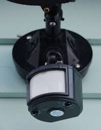 a motion detector used to control an outdoor automatic light