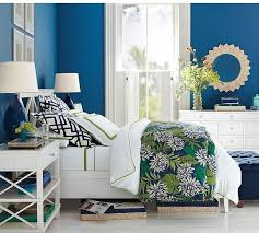 traditional bedroom with colorful modern graphic duvet cover and rustic wooden headboard
