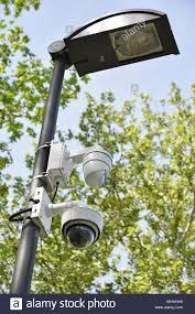 Outdoor Light Fixture Security Camera Security Cameras And A Street Light Outdoor Stock Photo