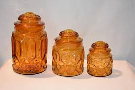 here for is a lot of 3 vintage amber glass cookie jars this piece is very thick and weighty and definitely has lots of age to it