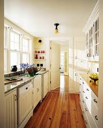 Bright galley kitchen with hardwood floors For the Home