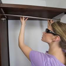 woman placing hang rods inside brackets