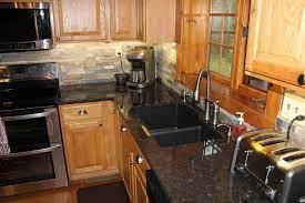 Kitchen countertops kitchen countertop materials: Cygnus Coffee Brown Granite Rustic Kitchen Kansas City By Midwest Marble Granite Houzz