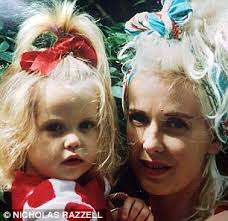 Peaches Geldof asa child pictured with her mother Paula Yates - article-0-1EFA628D00000578-578_306x297
