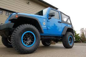 2012 jeep wrangler jk 2 door cosmos blue old man emu suspension lift 35 g km2 mud terrains kmc xd series rims