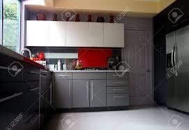 Glass Backsplash For Kitchen A Modern Kitchen With Gray Cabinets And Glass Backsplash Stock