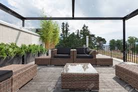 comfortable porch furniture. Stock Photo - View Of A Modern Patio With Comfortable Garden Furniture Porch R