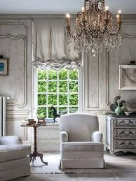 french country style living room oversized crystal chandelier makes a statement in this whitewashed room images of french country style living rooms