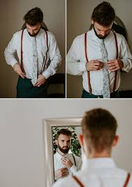 groom with brown leather suspenders and beard getting ready at palm harbor white chapel wedding