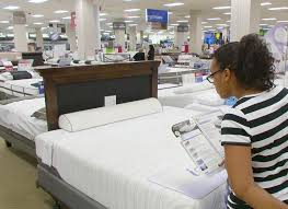 how to buy a new mattress. Plain Mattress A Young Woman Stops To Consider One Of Many Mattressess In A Large Well To How Buy New Mattress H