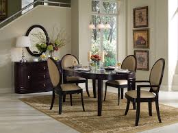 simple brown wooden small oval dining with padded wooden chairs soft beige carpet simple modern dining