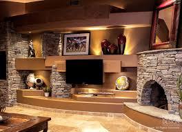 stone a wall design with kiva style corner fireplace custom designed by dagr design