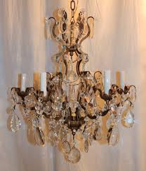 a wonderful french gilt bronze and cut crystal baguès style chandelier with beading and crystal flower