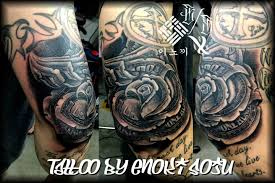 Black Ink Money Rose Tattoo On Right Elbow