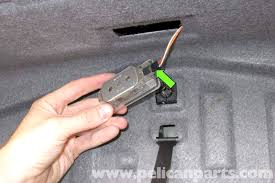 bmw e39 5 series trunk latch testing and replacement 1997 2003 lever out the trunk light lens using a flathead screwdriver