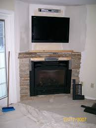 tv in the wall appealing corner stone stacked fireplace mantel f audio furniture ideas with black