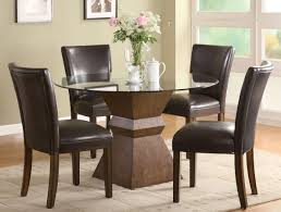 cal black cowhide dining chair design with round gl dining table with wooden geometrical beam with