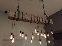 custom made reclaimed barn beam chandelier light fixture modern rustic restaurant bar