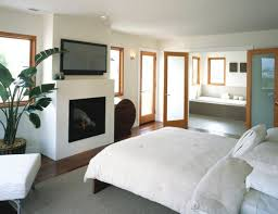 view in gallery trendy glass front fireplace in a luxury villa styled bedroom