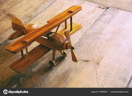 old wooden plane toy stock photo