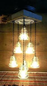 chandeliers glass insulator chandelier glass insulator chandelier industrial light fixture vintage heat grate glass art