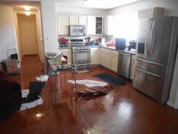 flooded kitchen wet water damaged wood flooring