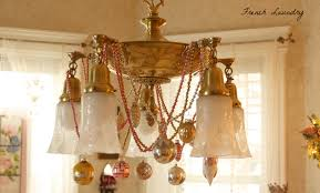 i typically always do this embellishment to my chandelier i d vintage mercury glass garlands and then hang vintage ornaments from them