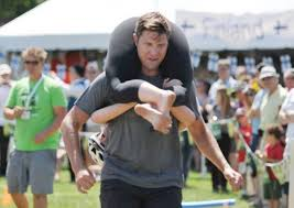 Midsummer Festival's wife-carrying winners collect refreshing ...